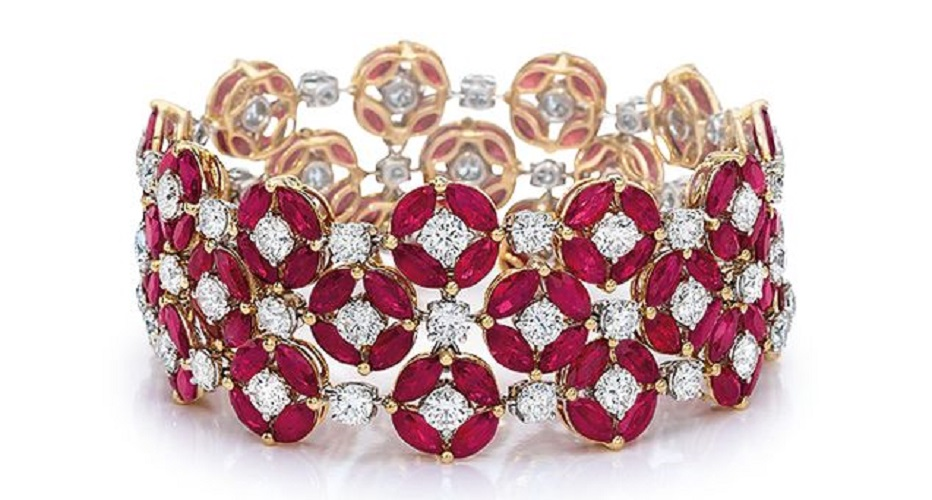 """Ruby and Diamond Bracelet - 3-row bracelet of marquise-shape rubies, in clusters of 4, forming circles with a round brilliant-cut diamond at each center, in a pattern with diamonds as connectors; in 18-karat rose gold. Dimensions: approx. 1"""" wide x 6 5/8"""" long. / Cellini Jewelers."""