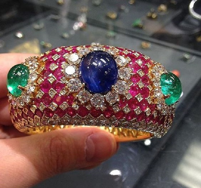 Sapphires and rubies and emeralds and diamonds come together as one spectacular bracelet.