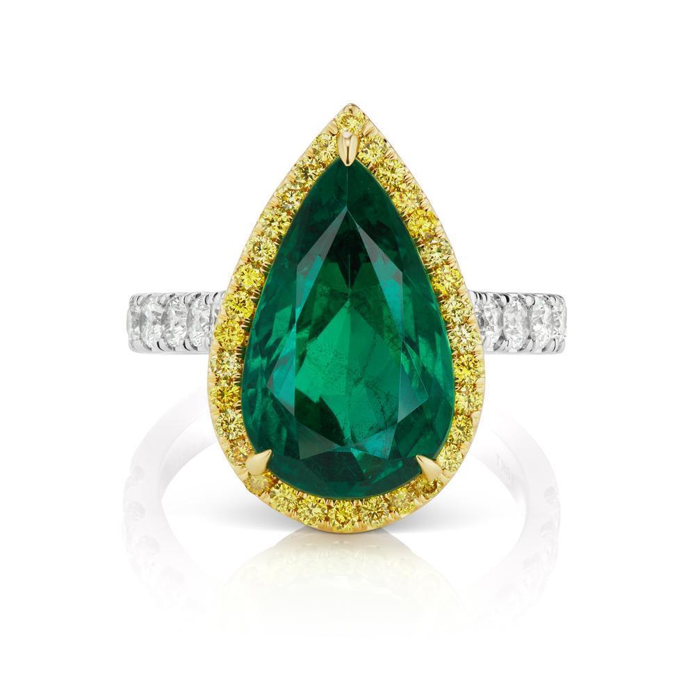 EMERALD AND DIAMOND RING A splendid emerald pear shape surrounded by a rich yellow diamond halo. A classic color combination in a contemporary styling.