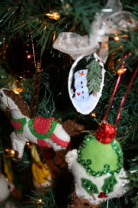 Assorted felt and painted ornaments