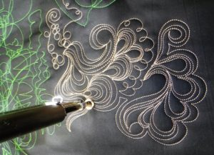 quilting in feathery swirls echoing around each other in 3 to 5 layers