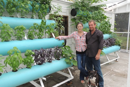 New farmers Lindsey Wightman and Theo Major use vertical hydroponic systems at Botanica Exchange in Cocoa.