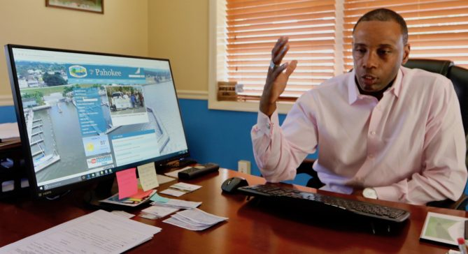 Chandler Williamson, city manager of Pahokee since 2015, shows off the redesigned website