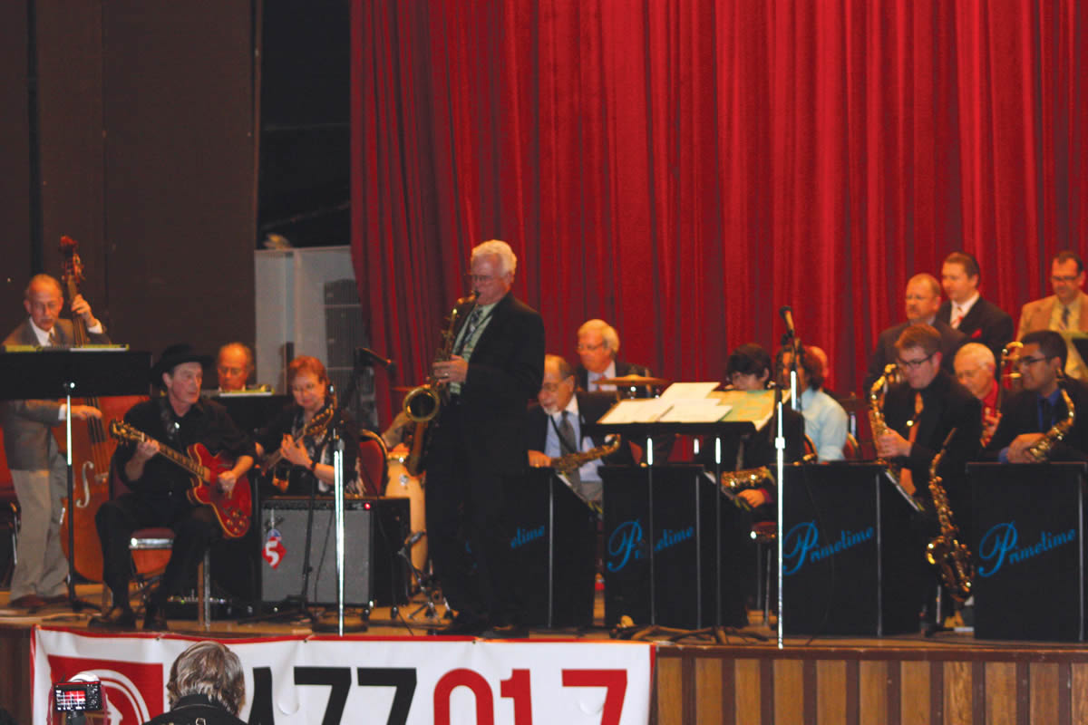 """Guitarist Jackie King (seated far left)performs with the UIW Jazz Ensemble, John Magaldi's Prime Time Jazz Orchestra, Butch Miles, John Panzarella, and Jim Waller during """"A Night of Jazz on Broadway."""""""