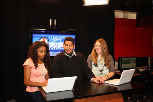 Students prepare for a broadcast in UIW's meteorology broadcast studio.