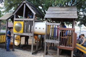 UIW students make repairs and paint a playset at the Lutheran House of Prayer as part of Meet the Mission.
