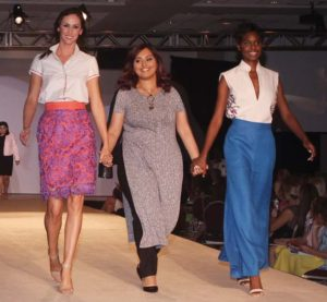 Maiti-Marquez walks the runway with models wearing her designs.