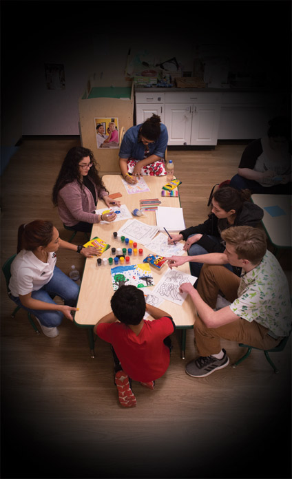Student teachers work with children in the community as part of their education training.