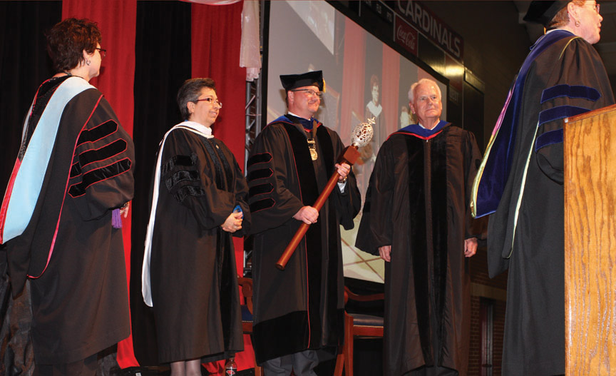Sr. Teresa Maya, CCVI congregational leader, and Charles Lutz, president of the Board of Trustees presented Evans with the University mace and presidential medallion.