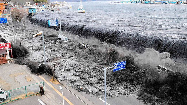 """""""The tsunami swamps Miyako on Friday, March 11. The coastal city was one of the worst hit along Japan's east coast."""" Source: HWT Image Library"""