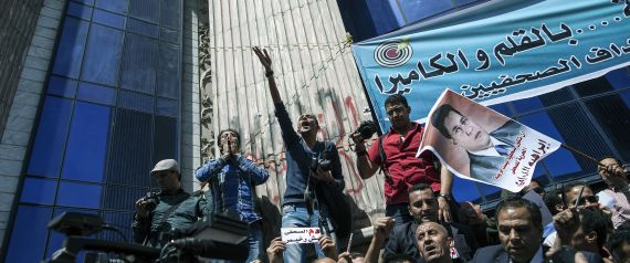 Journalists and photojournalists shout slogans as they demonstrate against repeated attacks on members of the press on April 17, 2014 in front of the building of the Press Syndicate in Cairo. The union asked the journalists working in Egypt to go on strike to ask for guarantee of safety and security while doing their jobs as they have faced an increasing amount of violence in recent years while covering protests and clashes. AFP PHOTO / MAHMOUD KHALED (Photo credit should read MAHMOUD | MAHMOUD KHALED via Getty Images