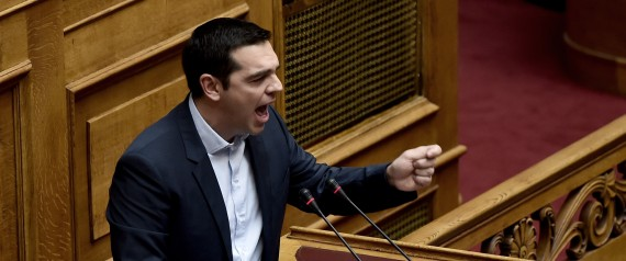 Greek Prime Minister Alexis Tsipras addresses the parliament in Athens on February 8, 2015 during his policy speech. Tsipras said on February 8 that Greece did not want an extension of its bailout but a 'bridge program' which would buy the country time to negotiate a new deal. AFP PHOTO / ARIS MESSINIS (Photo credit should read ARIS MESSINIS/AFP/Getty Images) | ARIS MESSINIS via Getty Images