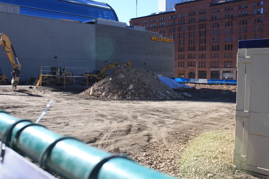 The asphalt from the surface lot has been removed and below grade work has begun on the SkyHouse residential project