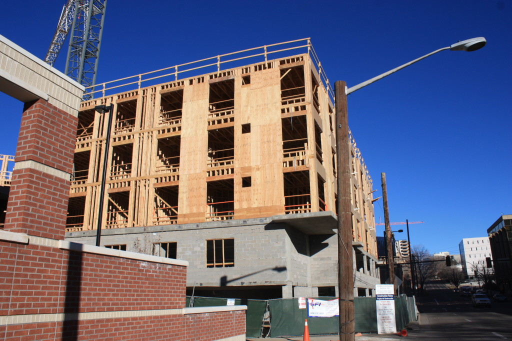 Apartments under construction at 8th and Broadway. Denver Urban Review Feb.2015