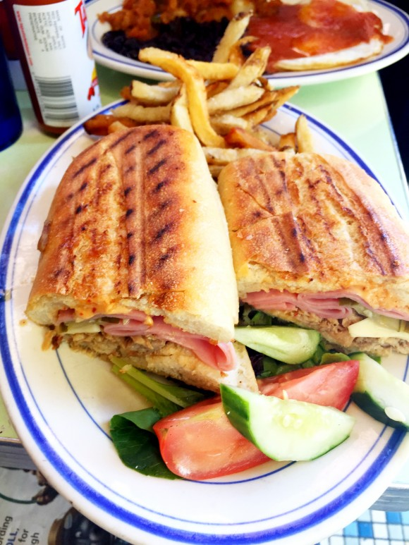 cuban sandwich with roasted pork, ham, swiss cheese, chipotle mayo and pickle