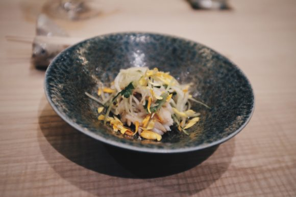 west coast dungeness crab with chrysanthemum flowers and cucumber