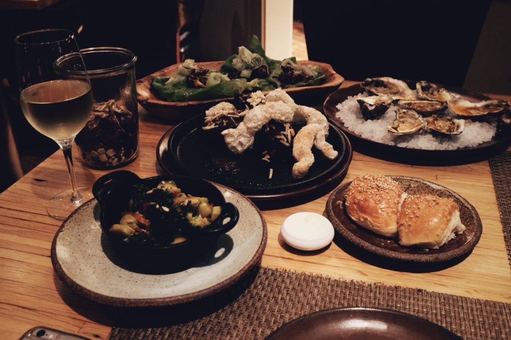 our dinner spread - wood fired oysters, slow smoked ribs, general tso's glazed pig ear lettuce wraps and charred broccoli