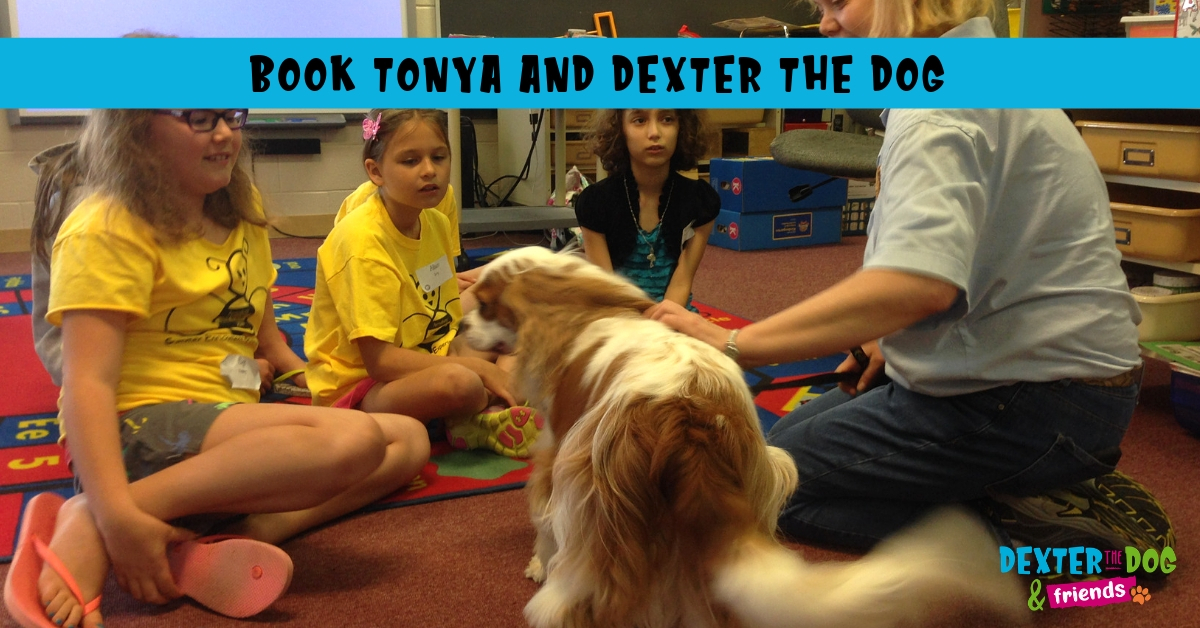 Children's authors with book signing dogs
