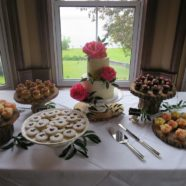 Coral peonies cake and sweet table