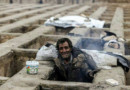 Pictures of homeless sleeping in empty graves shock Iran