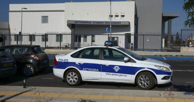 A police car parks in front of a station in Cyprus