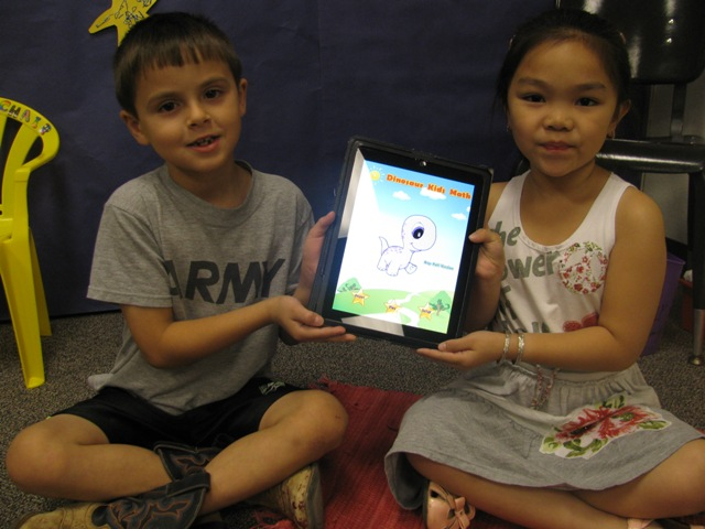 First Graders showing iPads