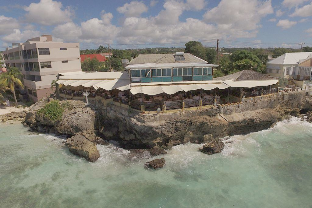 arial shot of retractable canvas canopy for a resturant on the south coast of Barbados
