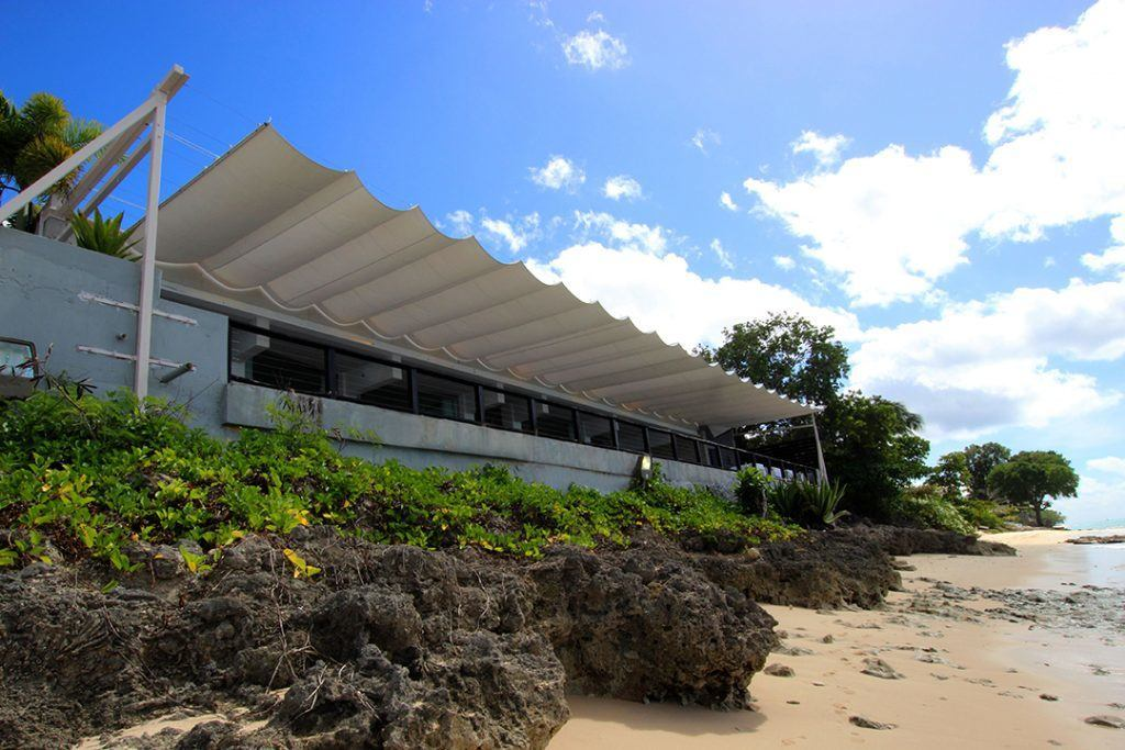 custom built retractable awning covering the balcony of Cin Cin resturant on the West Coast of Barbados