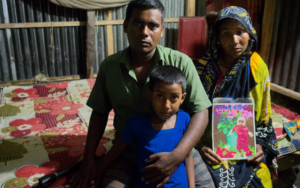 Abdul Hannan, the father of 6 year old Harun, who was kidnapped and killed, with his family in tebaria Bangladesh. Lazar Simeonov