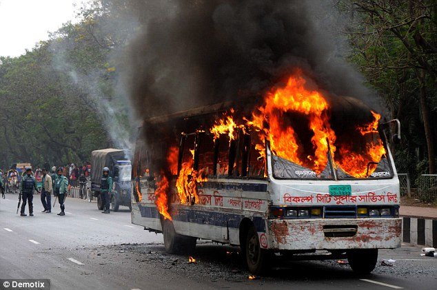 A bus in the Bangladeshi capital of Dhaka was set alight with a petrol bomb, which left an 18-year-old dead