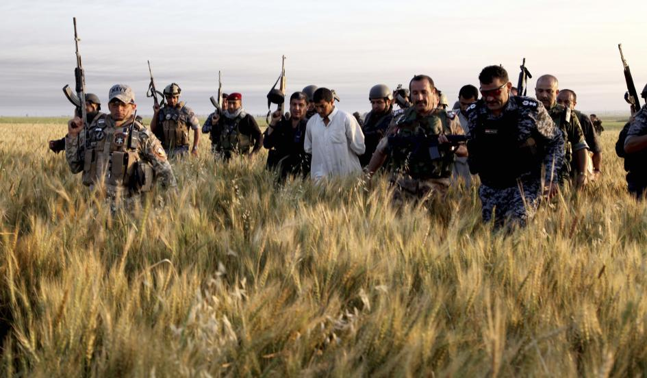 Iraqi security forces arrest suspected militants of the al Qaeda-linked Islamic State in Iraq and the Levant (ISIL) during a raid and weapons search operation in Hawija in this April 24 YAHYA AHMAD/REUTERS