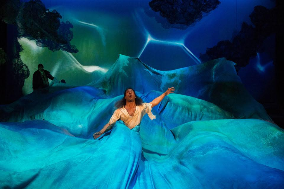 Pericles swathed in the silky blue waters of the Folger Shakespeare Library's production of Pericles by William Shakespeare