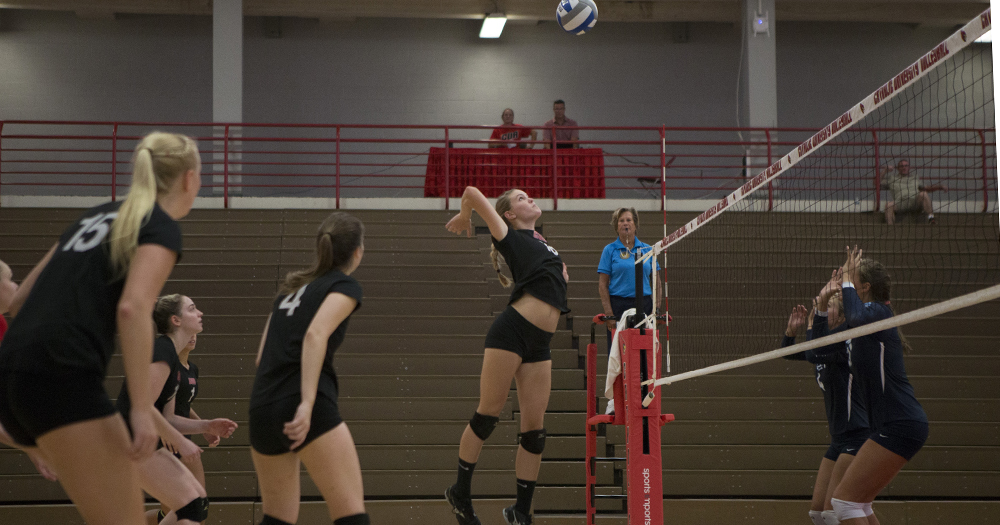 Senior middle hitter Kathryn Herrington rises up for a kill against Washington College. Courtesy of CUACardinals.com