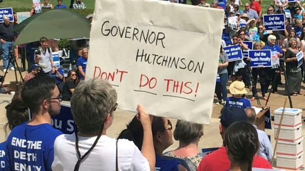 Protesters gather outside the state Capitol building on Friday, April 14, 2017, in Little Rock, Ark., to voice their opposition to Gov. Asa Hutchinson's plan to put seven men to death between April 17, and April 27, 2017. Hundreds showed up for the rally. (AP Photo/Kelly P. Kissel)