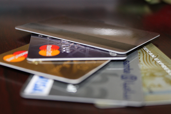 U.S. Credit Card Delinquencies Fall by a Third
