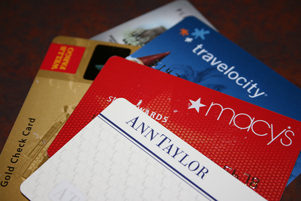 Americans' Credit Card Debt Slightly Up, Credit Scores Keep Falling