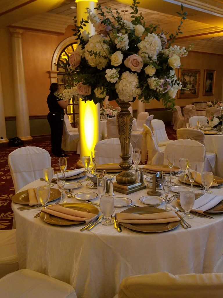 White Crush Tablecloths w/ Ivory Napkins and Silver Organza Sashes