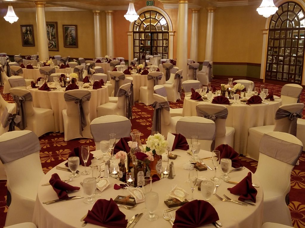 Ivory Tablecloths w/ Burgundy Napkins and Silver Majestic Sashes