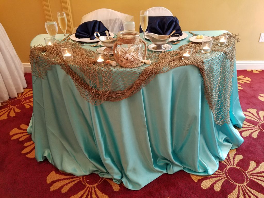 Light Blue Majestic Tablecloth with Navy Majestic Napkins and Sashes