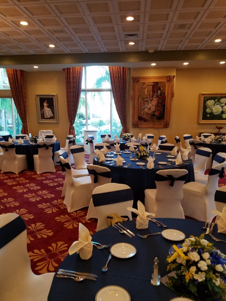 Navy Blue Sashes and Navy Blue Tablecloths with Ivory Napkins