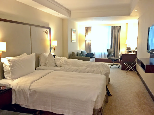 Pacific Grand room for family in Hong Kong