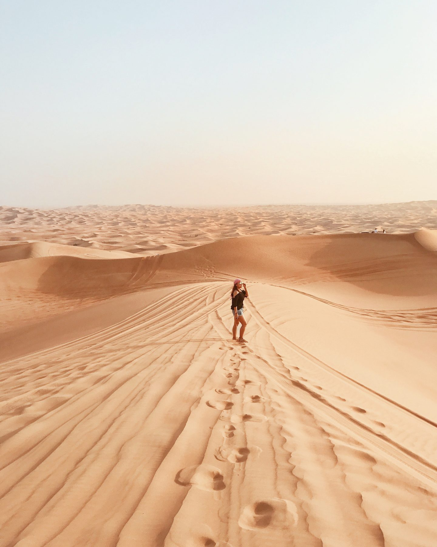 girl wanderlust in desert safari dubai