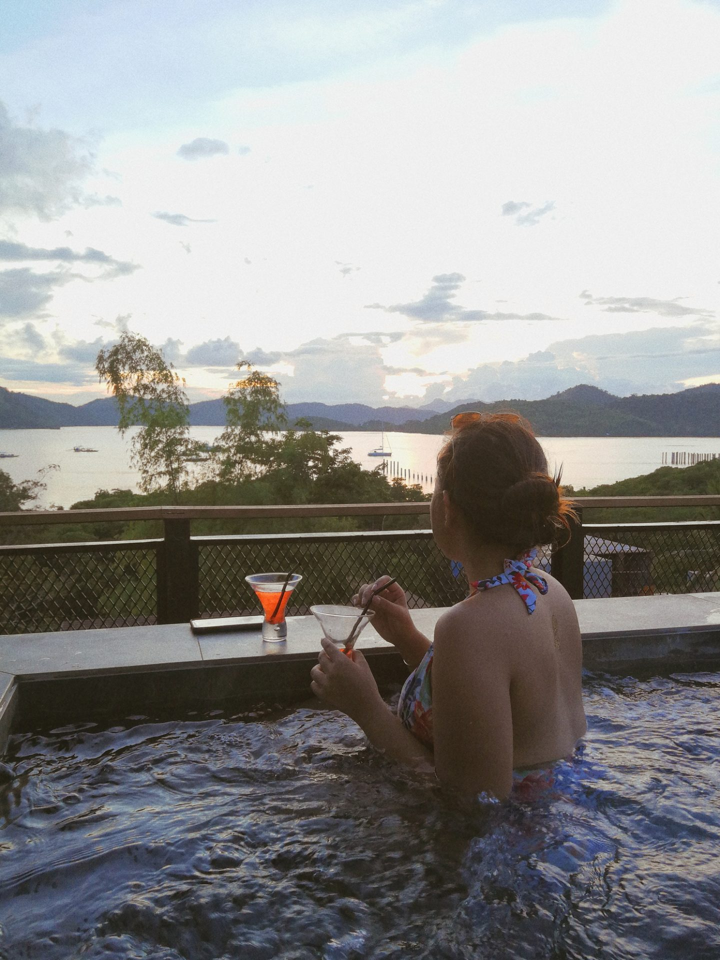 girl jacuzzi sunset watching with cocktails coron palawan