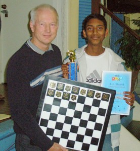 Vinay receives his trophy from IM Robert Jamieson