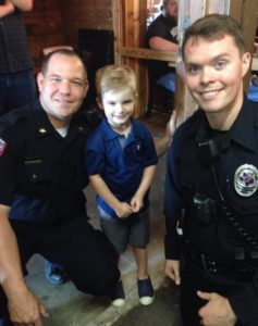 Two officers and children