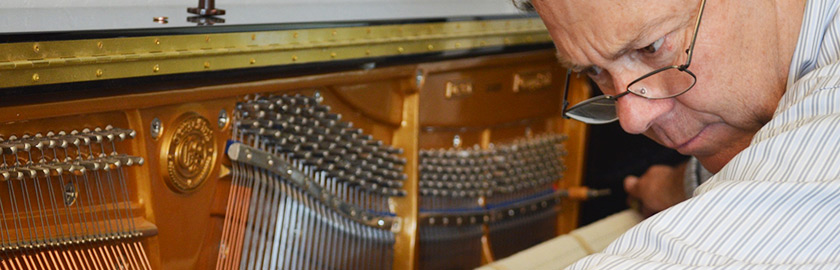 Randy Black servicing upright piano