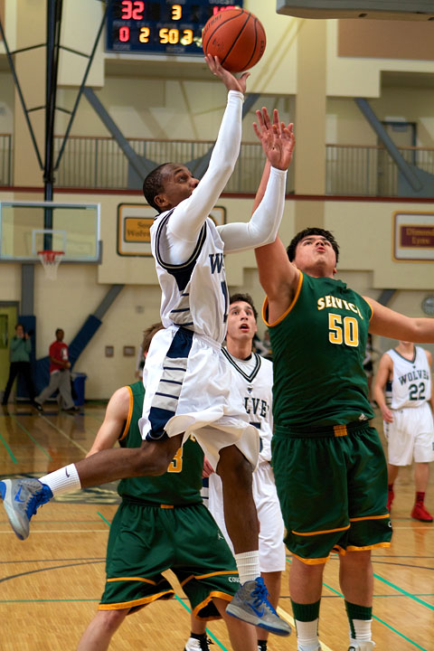 Senior Kelechi Madubuko goes up for a lay up against the Service Cougars