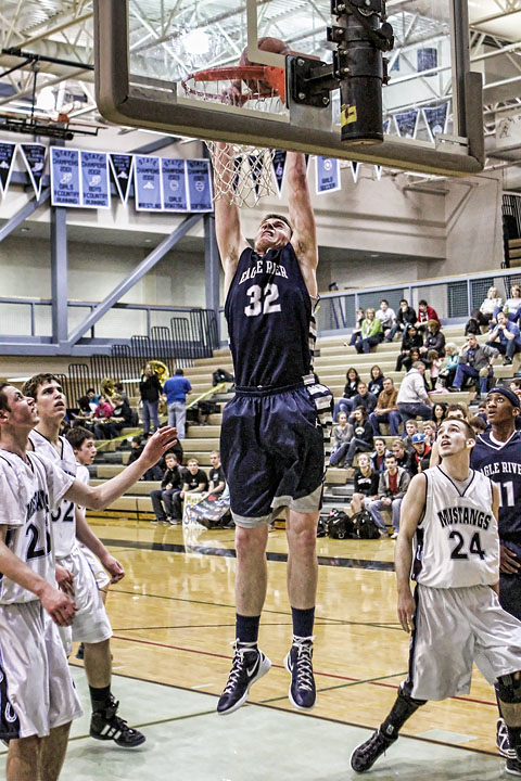 Senior Kevin Waterman heads to the rim for a dunk against Chugiak