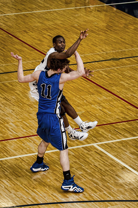 Senior Chris Parker is fouled on a deep three attempt late in the 4th quarter against Palmer