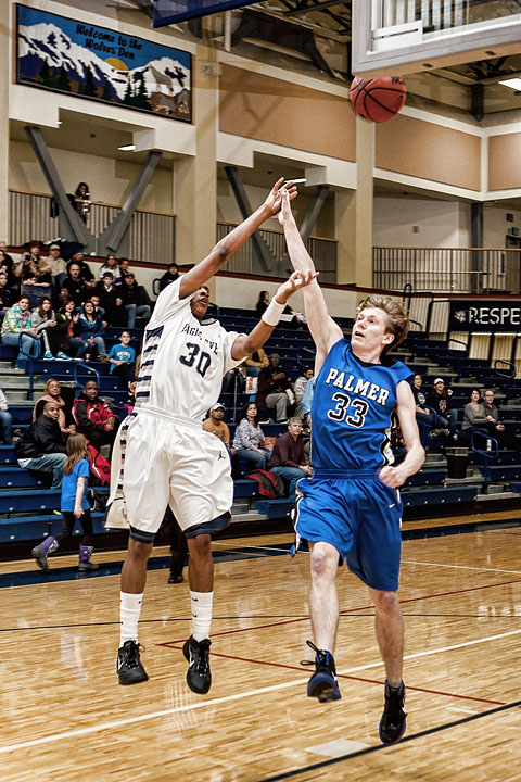 Freshman Chaz Jenkins throws up an incredible shot against Palmer in the Wolves Den